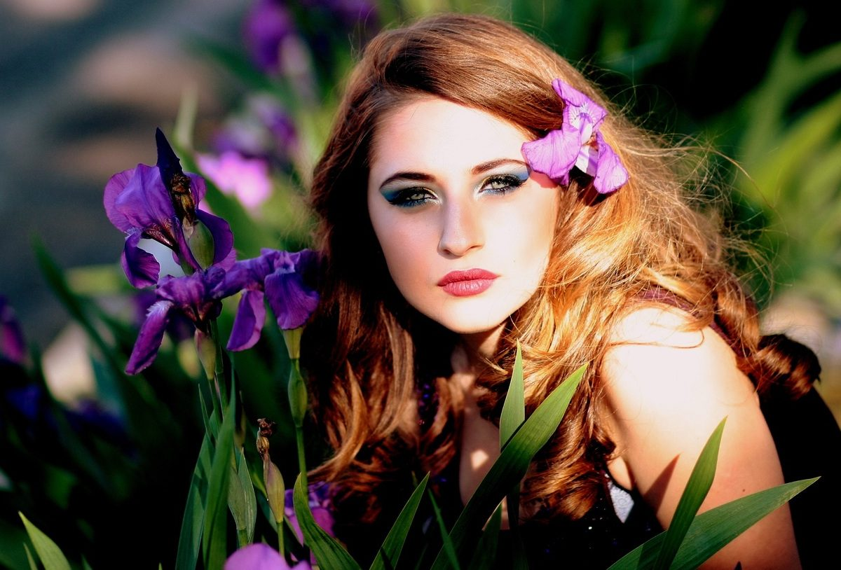 Beautiful lady on purple flower is amazed