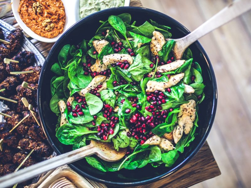 Green salad with red fruit pomegranate