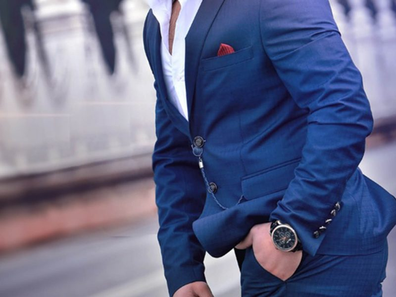 Men in blue coat and black watch looks