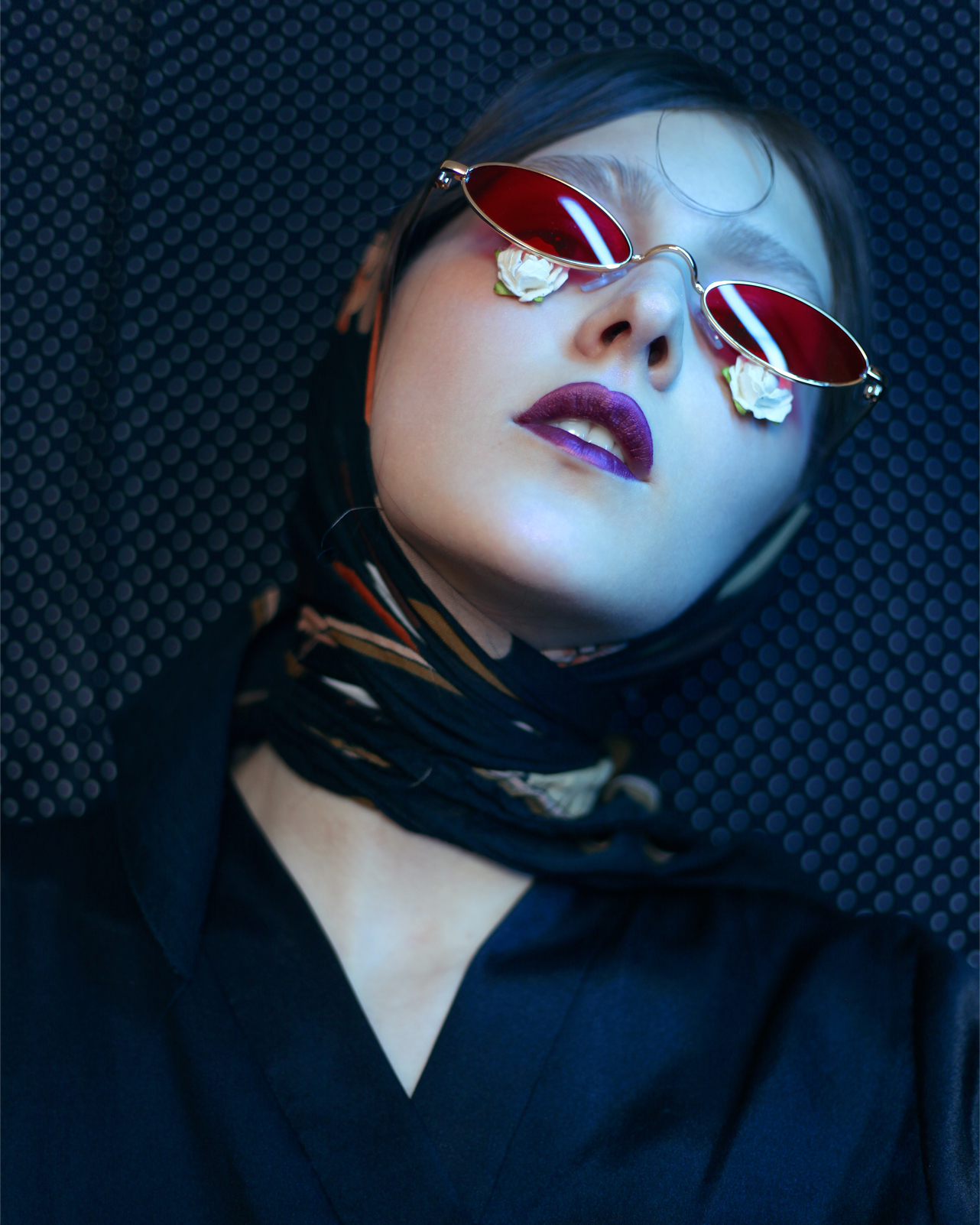 Women in dark with sun glass