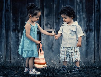 Small boy and girl in casual dress