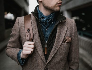 Men with brown coat & bag